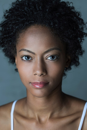 Portrait of woman with afro hair LANG_EVOIMAGES
