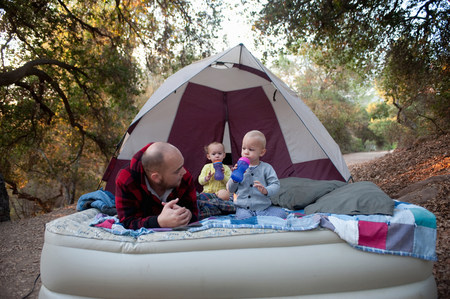 well behaved: Toddler twins on camping mattress with father LANG_EVOIMAGES