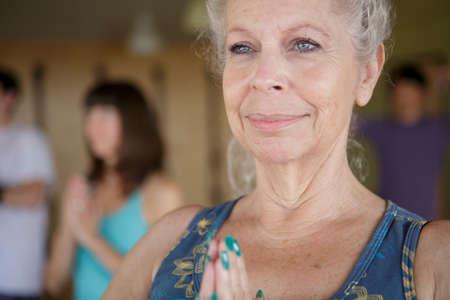 Close up of mature female in yoga class
