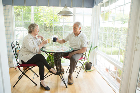 conservatories: Senior couple at table in conservatory