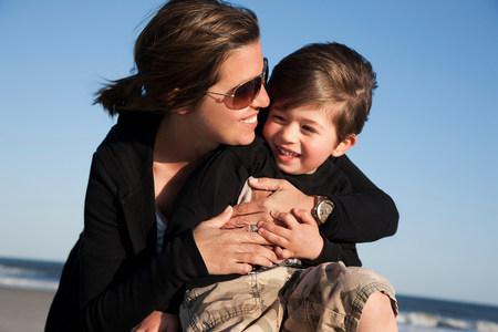 Mother hugging son LANG_EVOIMAGES