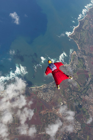 Woman in wingsuit flying above Honolulu,Hawaii