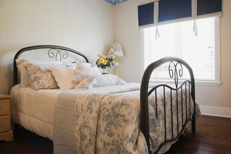 affluent: Traditionally styled bedroom with window blinds