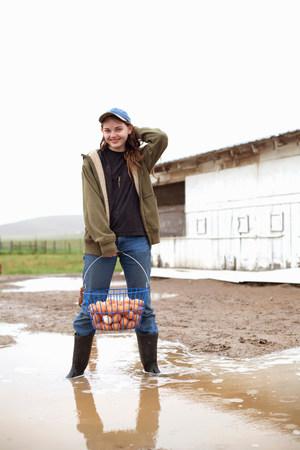 Girl carrying basket of eggs