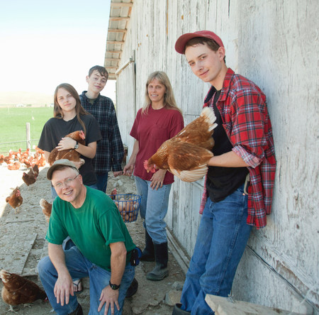 50 54 years: Farming family holding chickens,portrait