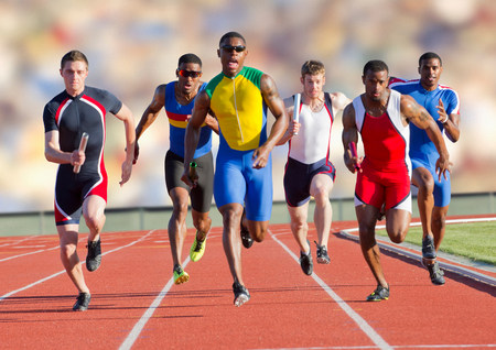 spandex: Six athletes running on race track LANG_EVOIMAGES