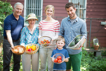 Three generation family with homegrown vegetables LANG_EVOIMAGES