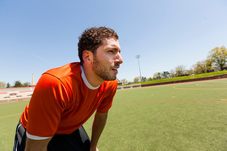 recuperating: Soccer player taking a break on pitch LANG_EVOIMAGES