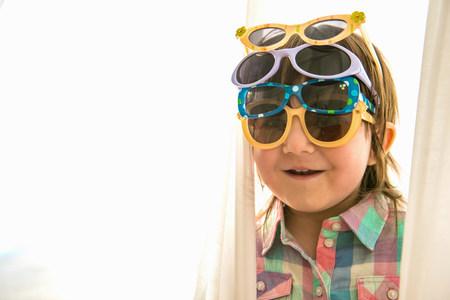 kooky: Girl wearing four paris of sunglasses