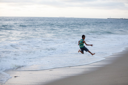 Boy jumping on Huntington Beach,California,USA LANG_EVOIMAGES