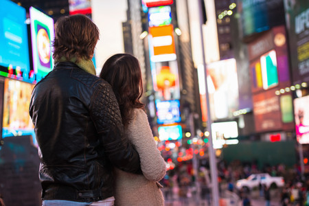 two persons only: Young couple looking up at neon signs, New York City, USA LANG_EVOIMAGES