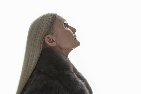 living wisdom: Studio shot of mature woman in profile