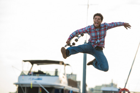 Skateboarder leaping for joy
