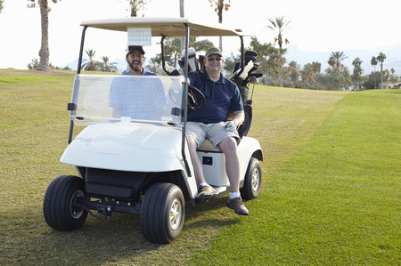 chillout: Portrait of two male golfers in golf buggy