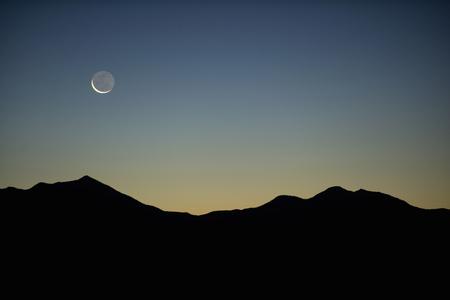 mountainous: Moon and mountains in silhouette,Moab,Utah,USA