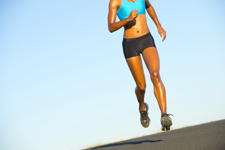 all under 18: Detail of young woman running on road LANG_EVOIMAGES