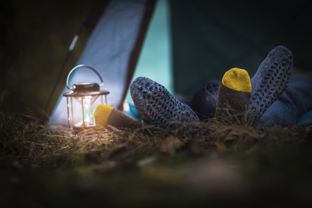 Couple lying in tent -  feet together