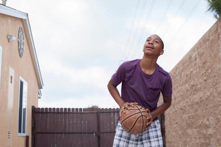 Boy holding basketball LANG_EVOIMAGES