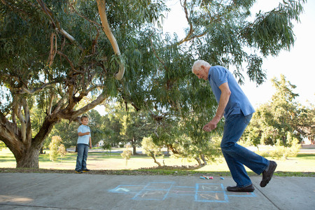 state of mood: Grandfather on hopscotch,boy watching