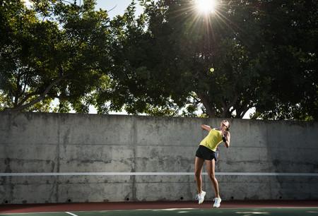 athletic wear: Female tennis player hitting ball