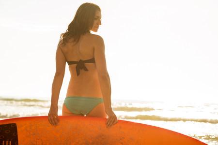 Young woman holding surfboard,La Jolla,San Diego,California,USA