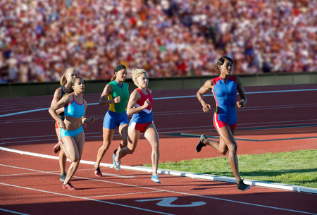 Runners racing on track