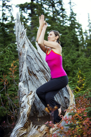 wa: Woman doing yoga,Bellingham,Washington,USA