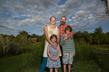 Portrait of couple with children on family herb farm LANG_EVOIMAGES