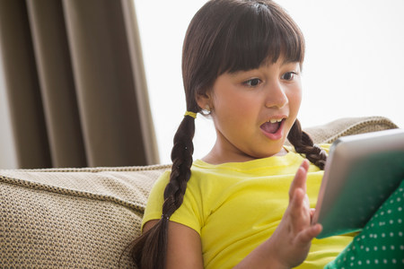 top 7: Girl using digital tablet with shocked expression
