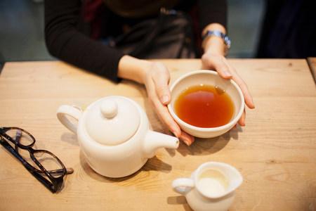 Woman holding cup of tea,high angle
