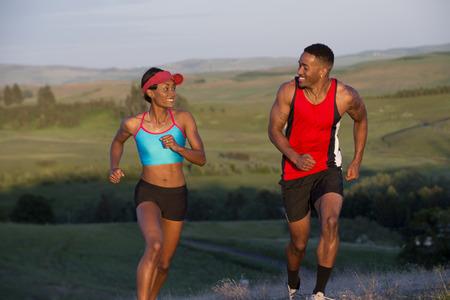 Young couple running in landscape,Othello,Washington,USA
