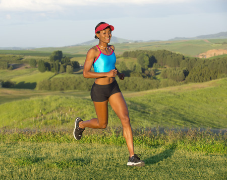 Young woman running in landscape,Othello,Washington,USA LANG_EVOIMAGES