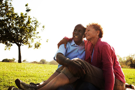 65 70 years: Portrait of senior couple sitting in park