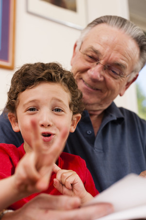 grampa: Portrait of young boy and grandfather playing LANG_EVOIMAGES