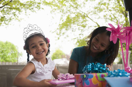 pinwheels: Mother with birthday girl opening presents