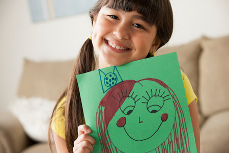 Girl holding picture of face