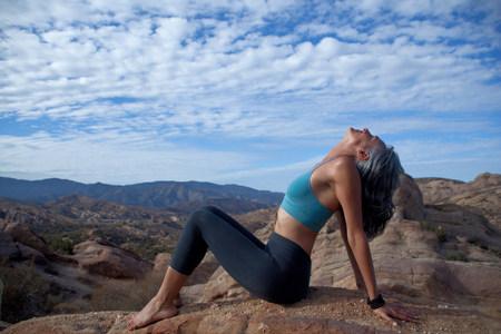 Woman sitting leaning back at Vazquez Rocks LANG_EVOIMAGES