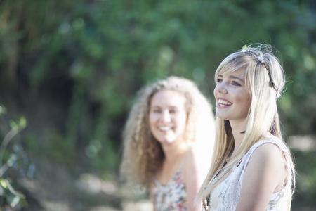 living idyll: Two teenage girls enjoying woodland LANG_EVOIMAGES