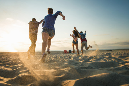 Friends running on Mission Beach,San Diego,California,USA LANG_EVOIMAGES
