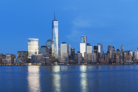 View of river and New York skyline at dusk