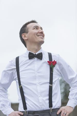 low self esteem: Informal portrait of smiling groom at wedding LANG_EVOIMAGES