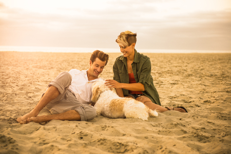 Young couple on Mission Beach with dog,San Diego,California,USA