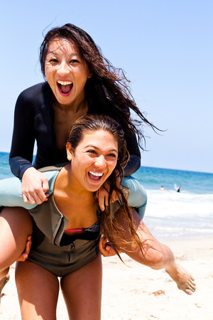 Female friends fooling around,Hermosa Beach,California,USA