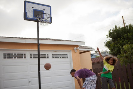 age 10 12 years: Two brothers playing basketball