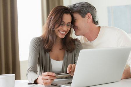multi age: Mature couple home shopping