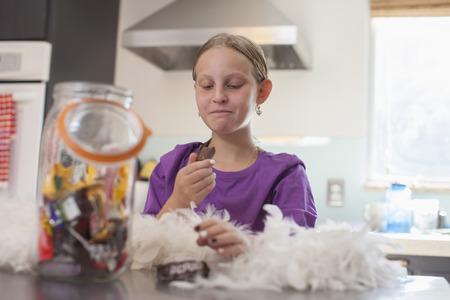 boas: Girl secretly enjoying biscuit from biscuit barrel LANG_EVOIMAGES