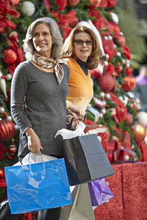 shopping buddies: Women with Christmas shopping