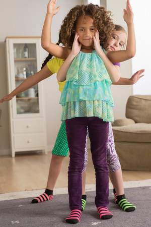 Three girls with arms out