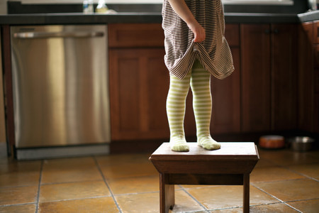 panty hose: Cropped shot of toddlers legs standing on stool in kitchen
