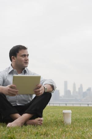 negative area: Businessman using laptop, Hoboken, New Jersey, USA